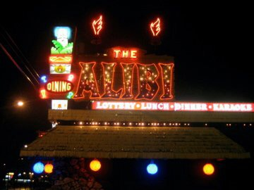Alibi sign at night picture by Laura