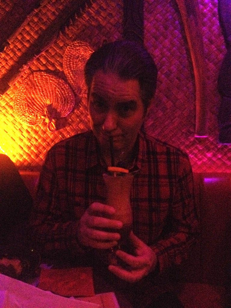 Andrew drinking a Hurricane at Hale Pele
