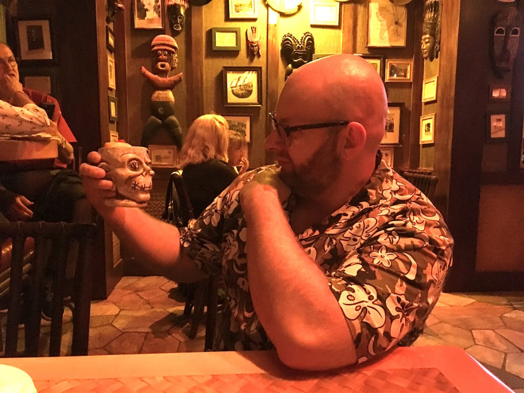 Ray pondering the Shrunken Zombie Head at Trader Sam's