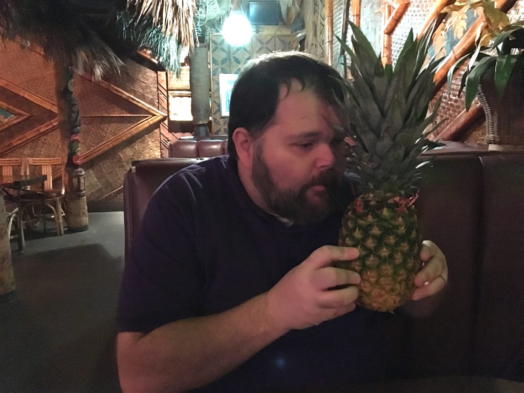 Joe drinking out of a pinneapple at Don The Beachcomber