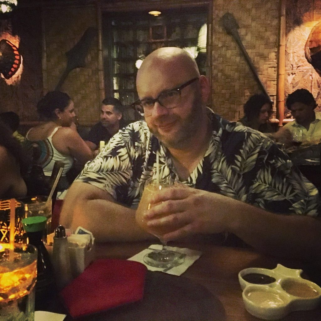 Ray drinking a Hukilau at The Mai Kai