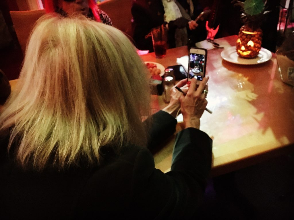 Taking a picture of Anita taking a picture of the pineapple jack-o-lantern