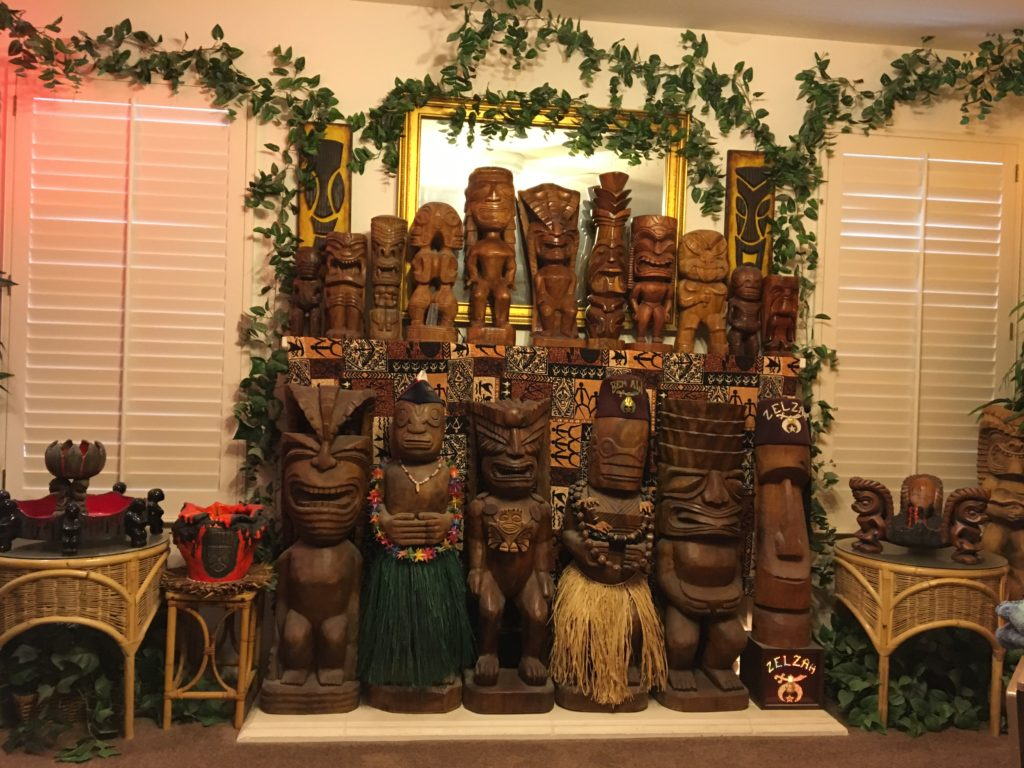 Tikis covering the fire place in the Family Room