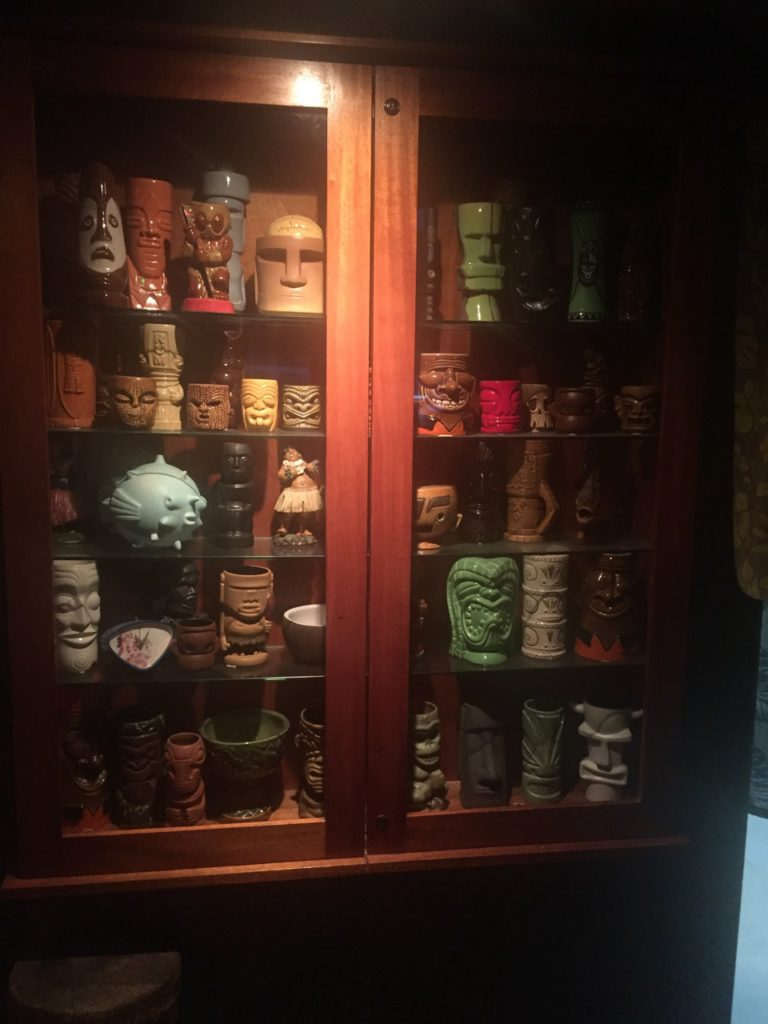 A fine collection of Tiki glasses is on display.