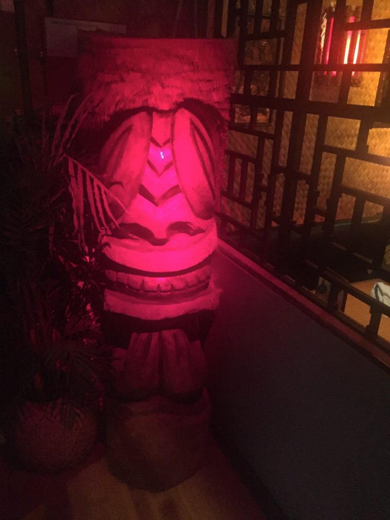 A Tiki greets all who enter the lounge.